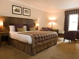 A bed or beds in a room at Old Loans Inn