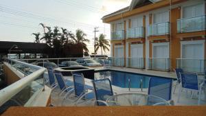The swimming pool at or near Juquei Frente ao Mar Hotel Pousada