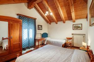 Ein Bett oder Betten in einem Zimmer der Unterkunft Dependance Hotel Corona