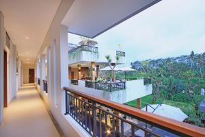 A balcony or terrace at Puri Padma Hotel
