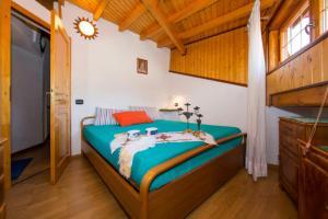 Ein Bett oder Betten in einem Zimmer der Unterkunft La Romantica