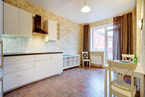 Кухня или мини-кухня в Welcome Home Apts Ligovsky 123