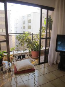 Uma área de estar em Apartamento Vista Mar - 2 Vagas