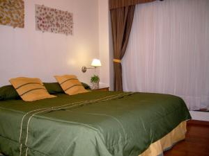 A bed or beds in a room at Apart San Lorenzo