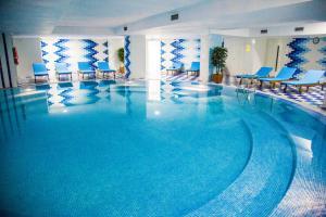 The swimming pool at or near Ramada by Wyndham Almaty