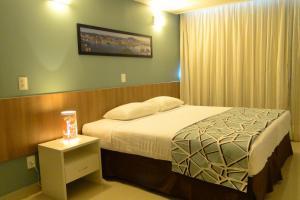 A bed or beds in a room at Bristol Alameda Vitória