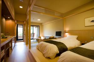 A bed or beds in a room at Mizunoto