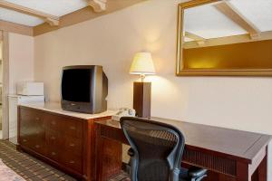 A television and/or entertainment center at Knights Inn Greensburg