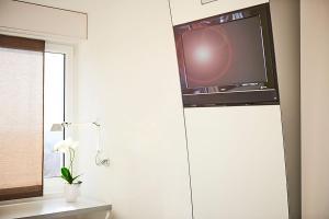 TV/Unterhaltungsangebot in der Unterkunft Le Leman Hotel