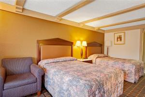A bed or beds in a room at Knights Inn Greensburg