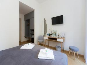 TV o dispositivi per l'intrattenimento presso Al 7 Small Luxury Rooms