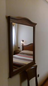 Cama o camas de una habitación en Hostal Granada