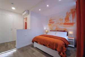Ein Bett oder Betten in einem Zimmer der Unterkunft Residenza Corso Saba