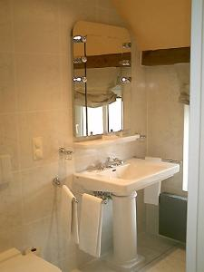 Ein Badezimmer in der Unterkunft Vielanker Brauhaus