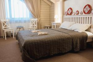Кровать или кровати в номере Шумихина Гора