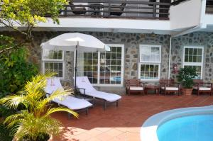 The swimming pool at or close to Marigot Palms Luxury Caribbean Apartment Suites