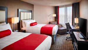 A bed or beds in a room at Best Western Plus Waterfront Hotel