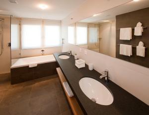 Ein Badezimmer in der Unterkunft Hotel Royal