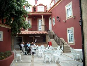 A restaurant or other place to eat at Falcao de Mendonca