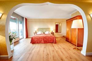 Ein Bett oder Betten in einem Zimmer der Unterkunft Cliff Hotel Rügen