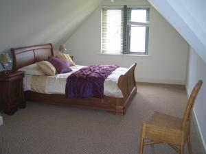 A bed or beds in a room at Superior Lodge at Lough Erne