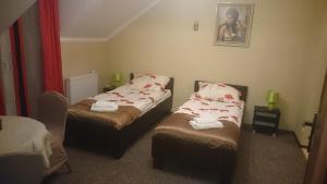 Łóżko lub łóżka w pokoju w obiekcie Fantazja Nad Zalewem
