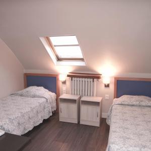 Cama o camas de una habitación en Est Hotel