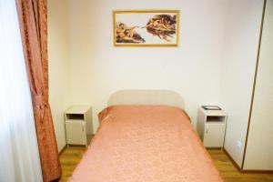 Кровать или кровати в номере Оскар