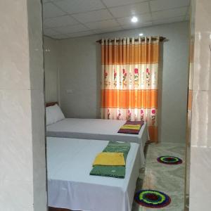 Giường trong phòng chung tại Phong Nha Backpacker Hostel