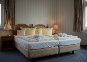 Ein Bett oder Betten in einem Zimmer der Unterkunft Haus Hainstein