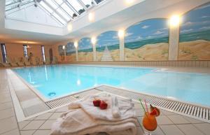 Der Swimmingpool an oder in der Nähe von Akzent Hotel Am Burgholz