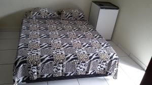 Cama ou camas em um quarto em Hotel Pousada Praia e Sol