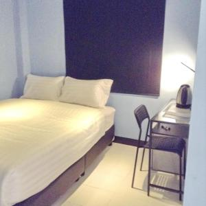 A bed or beds in a room at The Mix Bangkok - Phrom Phong