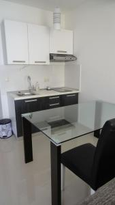 A kitchen or kitchenette at Apartments Tomić