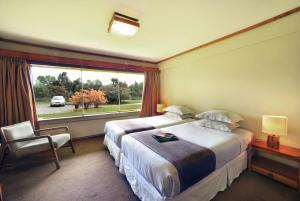 Cama o camas de una habitación en Hotel Naguilan