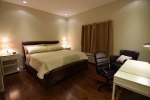 Кровать или кровати в номере The Lion Inn & Suites