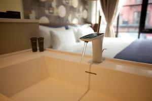 Ein Badezimmer in der Unterkunft NobleDEN Hotel