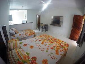 A bed or beds in a room at Suítes do Cid