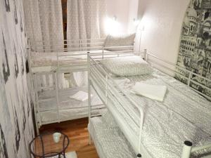 A bed or beds in a room at Kremlin Lights - Rent Rooms