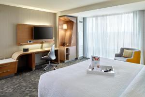 A bed or beds in a room at Courtyard by Marriott Orlando Lake Nona