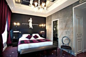 Un ou plusieurs lits dans un hébergement de l'établissement Maison Albar Hotels Le Champs-Elysées