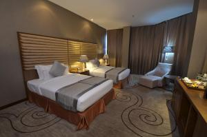 A bed or beds in a room at Fleuve Congo Hotel By Blazon Hotels