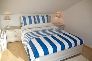 Un ou plusieurs lits dans un hébergement de l'établissement Vakantievilla Aan Zee
