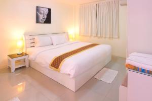 A bed or beds in a room at Grand Condo Jasmine Pool Villa near the beach