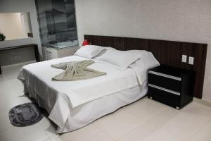 A bed or beds in a room at Vera Cruz Business Hotel