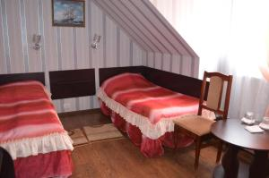 A bed or beds in a room at Hotel Fiyesta