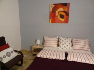 A bed or beds in a room at Apartamenty Polna