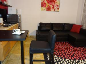 The lounge or bar area at Apartamenty Polna