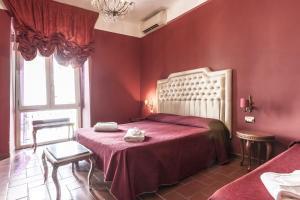Un ou plusieurs lits dans un hébergement de l'établissement Hotel Foro Romano Imperatori