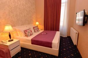 A bed or beds in a room at King David Hotel